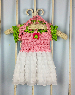 24 patterns in this Crochet Dress Roundup compiled by SimplyCollectibleCrochet.com | English Rose Baby Dress and Shrug by Part Pixy