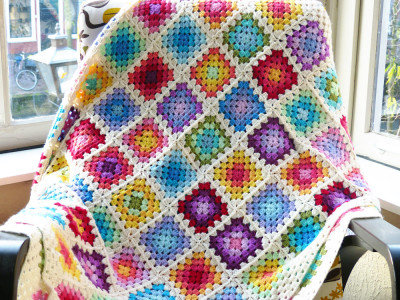 22 Granny Square Projects | Rainbow Granny Square Blanket by Haak Maar Raak