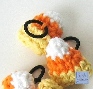 Candy Corn Amigurumi Hair Ties #crochet pattern and tutorial by SimplyCollectibleCrochet.com