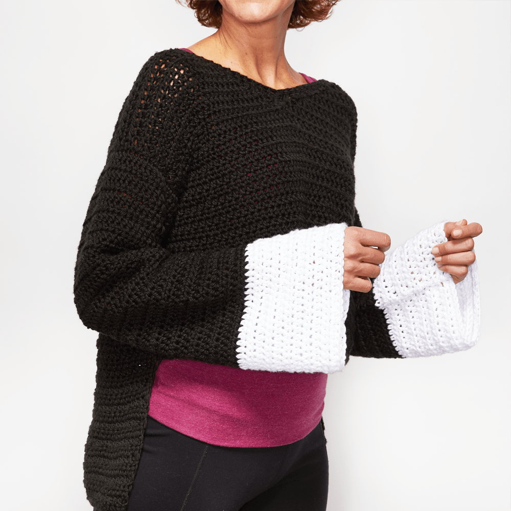 If you're feeling daring and want to try something new, consider the Wide Sleeve Sweater. #crochetpattern #crochettop #crochetsweater #crochetlove #crochetaddict
