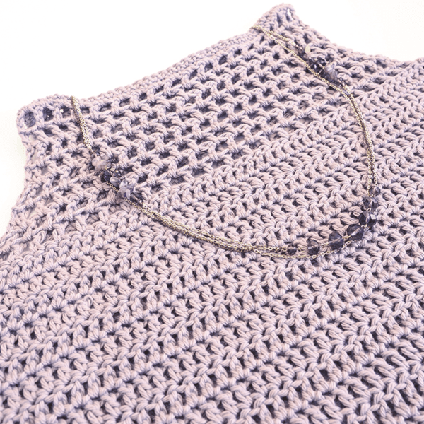 This Light Crochet Tank Top is a clean, minimalist basic that can be paired with jeans, shorts, or even tucked into a skirt. #crochettop #crochettanktop #crochetpattern #crochetlove #crochetaddict
