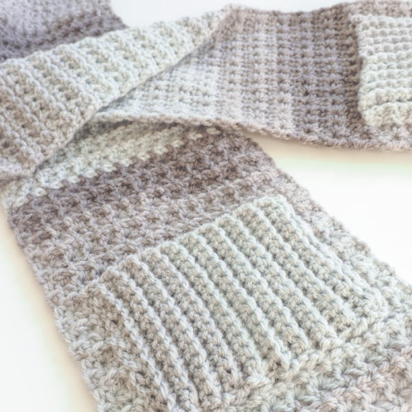 What makes the Cozy Pocket Scarf different from any other scarf are the little pockets on each end which is perfect for warming your hands. #crochetscarf #crochetpattern #crochetlove #crochetaddict