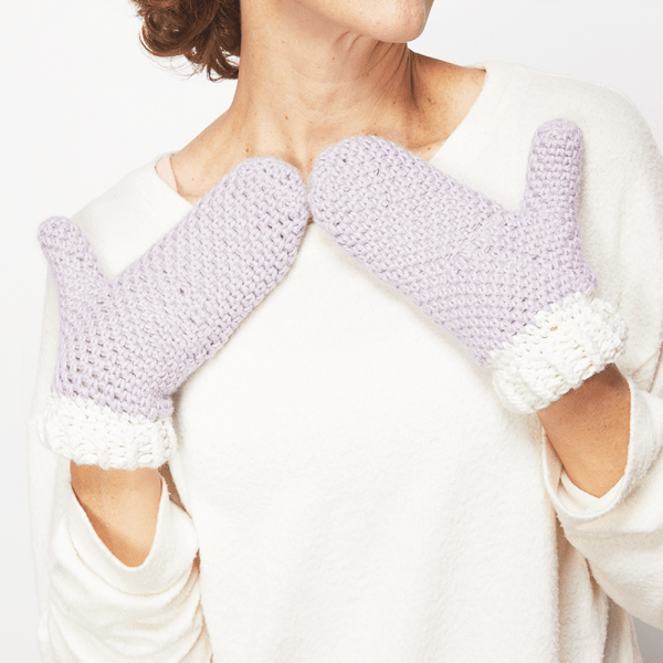 These crochet mittens are so easy to put together. The free crochet pattern is really easy to follow and you'll end up with a snuggly pair of gloves. #CrochetMittens #CrocheGloves #CrochetAddict #FreeCrochetPattern