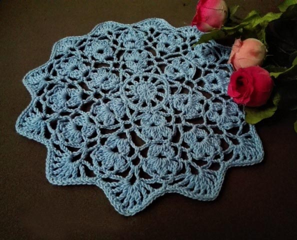 Flower Wheel Doily - Crochet doily patterns are unique and a great investment of time. They take skill and attention to detail and are perfect for relaxing. #crochetpatterns #crochetdoilypatterns #freecrochetpatterns #crochetaddict