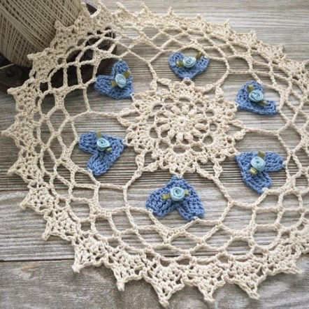 Heart Blossoms Crochet Doily - Crochet doily patterns are unique and a great investment of time. They take skill and attention to detail and are perfect for relaxing. #crochetpatterns #crochetdoilypatterns #freecrochetpatterns #crochetaddict
