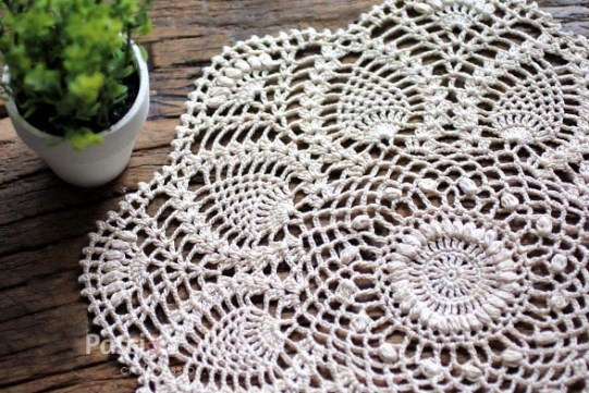 Pineapple Doily - Crochet doily patterns are unique and a great investment of time. They take skill and attention to detail and are perfect for relaxing. #crochetpatterns #crochetdoilypatterns #freecrochetpatterns #crochetaddict