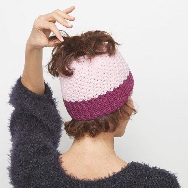 This crochet messy bun hat is sweet and simple, and fun to work on. This is a great crochet pattern to make for yourself or a woman you know. #CrochetMessyBunHat #CrochetHatPattern #CrochetPattern