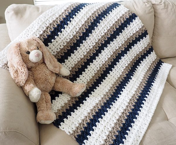 Easy Done-in-a-Day Baby Blanket - These free crochet afghan patterns are unique and fitting for any situation. Whether you're making a crochet baby blanket or a lapghan. #CrochetBlanketPatterns #DoubleCrochetBlankets #FreeCrochetPatterns