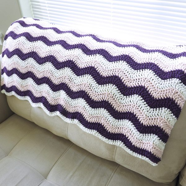 The little ripple crochet baby blanket is sweet and simple. This crochet pattern will stand the test of time and can truly be a special keepsake. #CrochetBabyBlanket #BabyBlankets #BlanketCrochetPattern