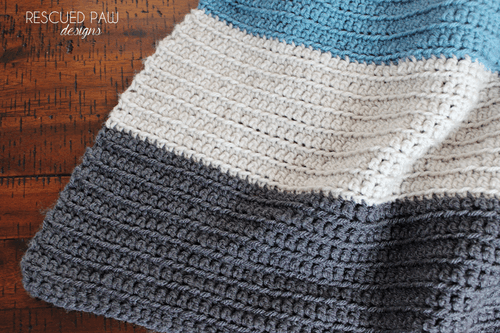 Simple Stripes Crochet Blanket - These free crochet afghan patterns are unique and fitting for any situation. Whether you're making a crochet baby blanket or a lapghan. #CrochetBlanketPatterns #DoubleCrochetBlankets #FreeCrochetPatterns