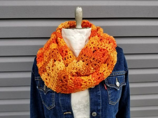 Autumn Sunrise Infinity - If you're thinking of an easy project to do this fall, look no further than these crochet infinity scarf patterns. #crochetscarf #crochetinfinityscarfpatterns #crochetpatterns