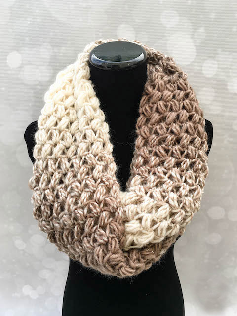 Coffee Bean Infinity Scarf - If you're thinking of an easy project to do this fall, look no further than these crochet infinity scarf patterns. #crochetscarf #crochetinfinityscarfpatterns #crochetpatterns
