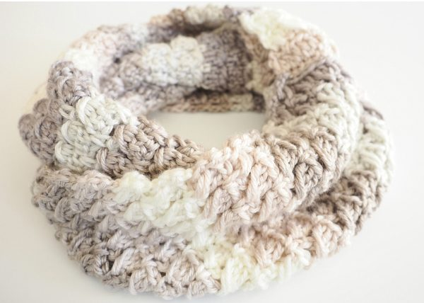 Cross-Over Block Stitch Infinity Scarf - If you're thinking of an easy project to do this fall, look no further than these crochet infinity scarf patterns. #crochetscarf #crochetinfinityscarfpatterns #crochetpatterns