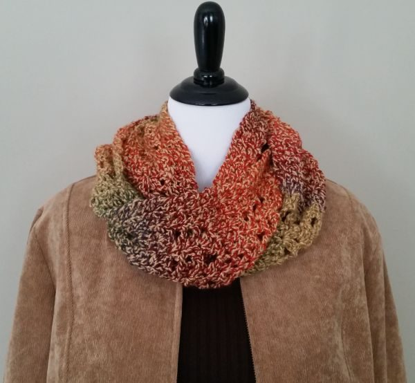 Fall Sunburst Infinity Scarf - If you're thinking of an easy project to do this fall, look no further than these crochet infinity scarf patterns. #crochetscarf #crochetinfinityscarfpatterns #crochetpatterns
