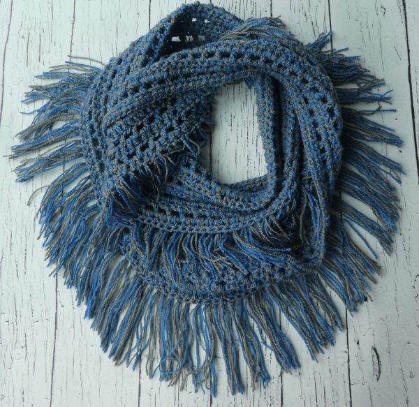 Laura Crochet Fringe Infinity Scarf - If you're thinking of an easy project to do this fall, look no further than these crochet infinity scarf patterns. #crochetscarf #crochetinfinityscarfpatterns #crochetpatterns