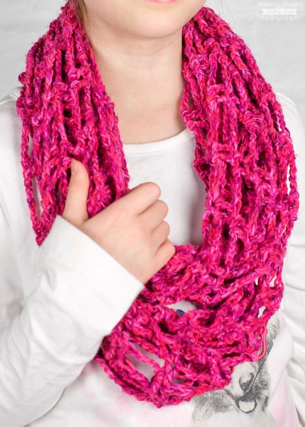 Lightweight Crochet Infinity Scarf - If you're thinking of an easy project to do this fall, look no further than these crochet infinity scarf patterns. #crochetscarf #crochetinfinityscarfpatterns #crochetpatterns