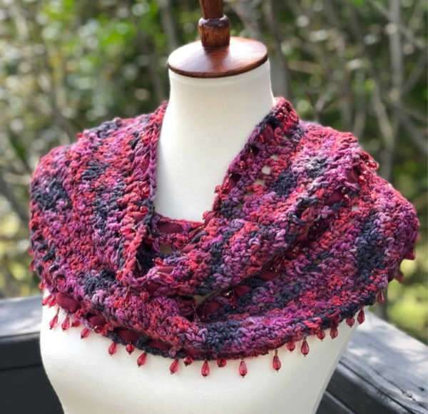 Ribbons & Bling Infinity Scarf - If you're thinking of an easy project to do this fall, look no further than these crochet infinity scarf patterns. #crochetscarf #crochetinfinityscarfpatterns #crochetpatterns