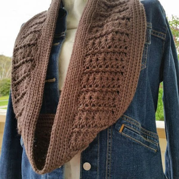 Taupe Infinity Scarf - If you're thinking of an easy project to do this fall, look no further than these crochet infinity scarf patterns. #crochetscarf #crochetinfinityscarfpatterns #crochetpatterns