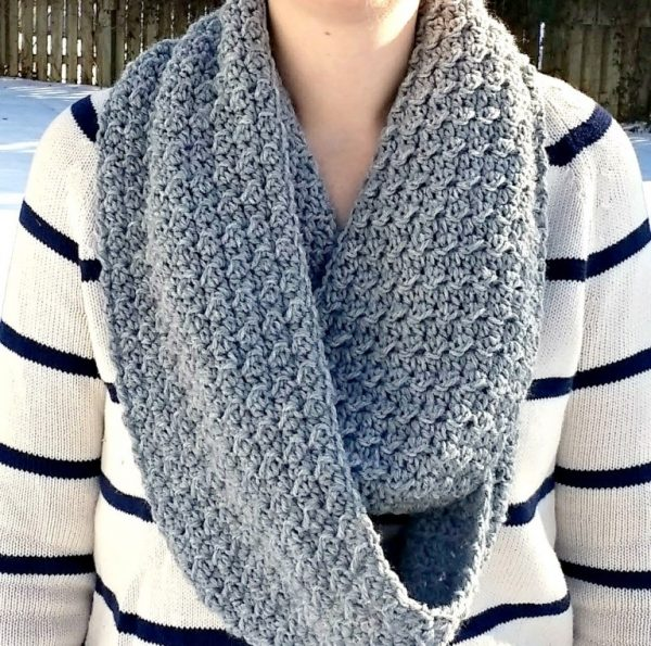 The Cambridge Infinity Scarf - If you're thinking of an easy project to do this fall, look no further than these crochet infinity scarf patterns. #crochetscarf #crochetinfinityscarfpatterns #crochetpatterns