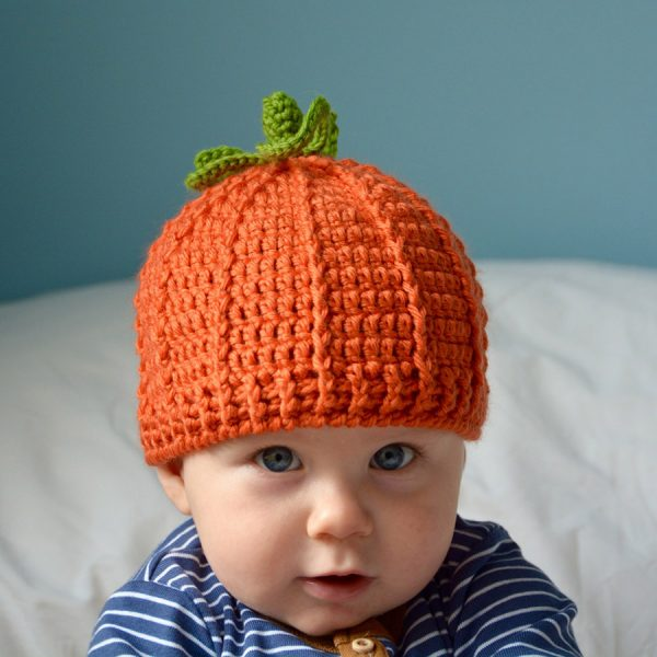The Pumpkin Beanie Hat - We have put together a list of simple crochet patterns that remind us all of fall. #simplecrochetpatterns #fallcrochetpatterns #easycrochetpatterns