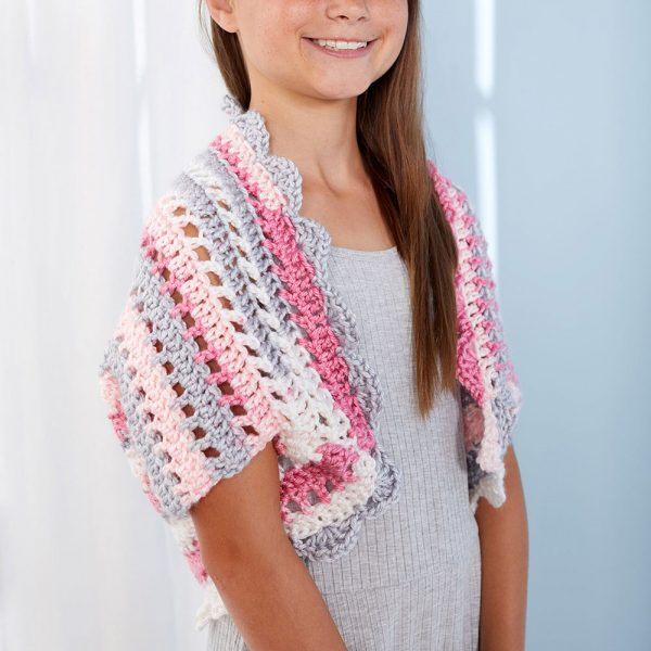 Adorable Girl's Shrug - Interested in making a few shrugs for yourself and/or to gift? Check out these 27 beginner crochet shrug patterns! #crochetshrugpatterns #crochetpatterns #shrugcrochetpatterns
