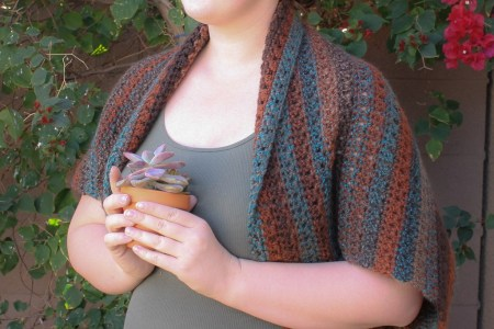 Bette's Winter Blanket Shrug - Interested in making a few shrugs for yourself and/or to gift? Check out these 27 beginner crochet shrug patterns! #crochetshrugpatterns #crochetpatterns #shrugcrochetpatterns