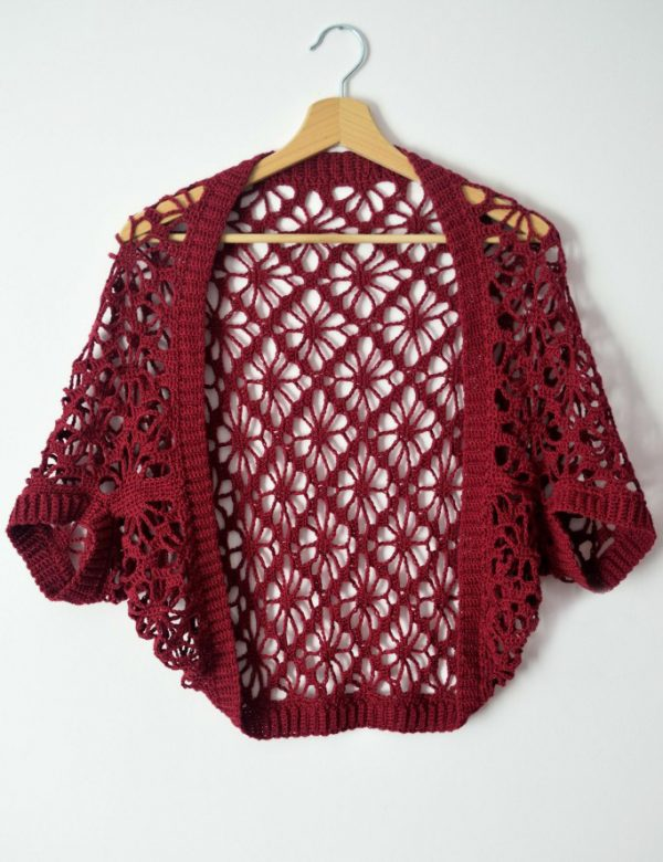 Meadow Lace Shrug - Interested in making a few shrugs for yourself and/or to gift? Check out these 27 beginner crochet shrug patterns! #crochetshrugpatterns #crochetpatterns #shrugcrochetpatterns