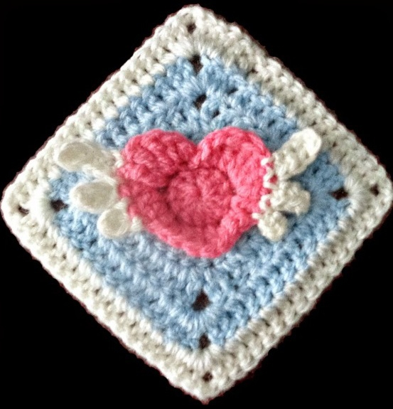 Angel Heart Granny Square - This holiday season have tons of fun creating these fun and festive granny squares crochet patterns for whatever project you have in mind. #grannysquarepatterns #crochetpatterns #Holidaygrannysquarepatterns