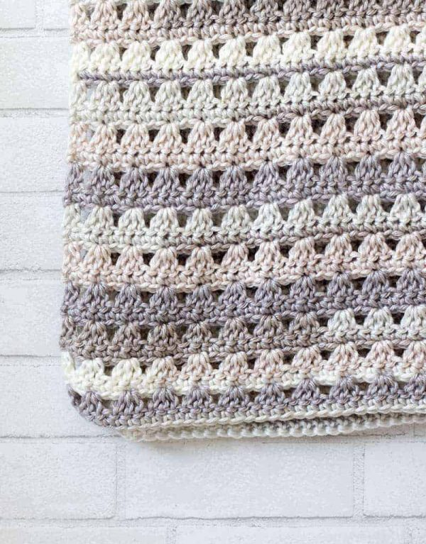 Alissa Easy Crochet Throw Blanket - This list of 17 easy crochet afghan patterns has a good variety of styles and stitches that will allow you to flex your crochet muscle. #easycrochetafghanpatterns #crochetafghanpatterns #crochetpatterns