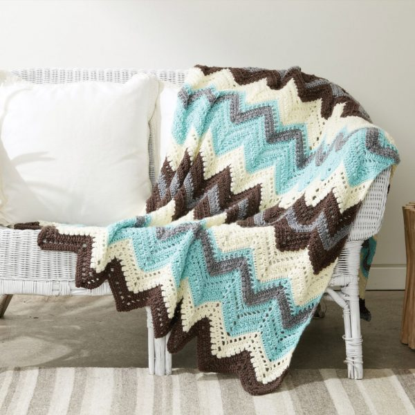 Caron Cabin In The Woods Crochet Afghan - This list of 17 easy crochet afghan patterns has a good variety of styles and stitches that will allow you to flex your crochet muscle. #easycrochetafghanpatterns #crochetafghanpatterns #crochetpatterns