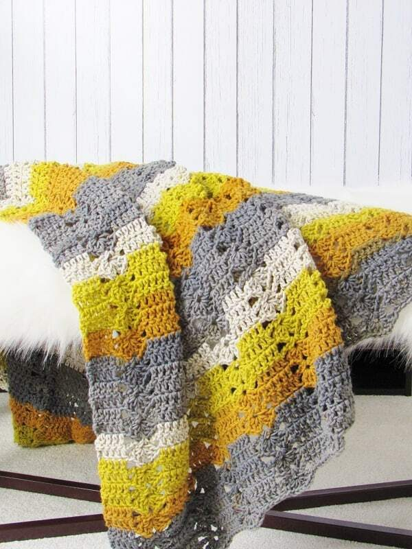 Fireplace Afghan - This list of 17 easy crochet afghan patterns has a good variety of styles and stitches that will allow you to flex your crochet muscle. #easycrochetafghanpatterns #crochetafghanpatterns #crochetpatterns