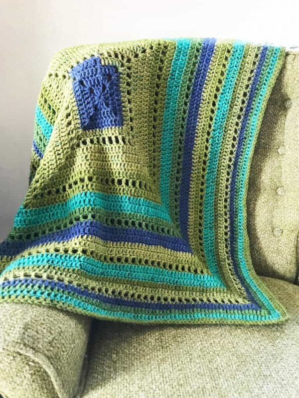 Granny Filet Square Afghan - This list of 17 easy crochet afghan patterns has a good variety of styles and stitches that will allow you to flex your crochet muscle. #easycrochetafghanpatterns #crochetafghanpatterns #crochetpatterns