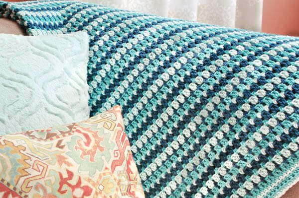 Sea Glass Crochet Afghan - This list of 17 easy crochet afghan patterns has a good variety of styles and stitches that will allow you to flex your crochet muscle. #easycrochetafghanpatterns #crochetafghanpatterns #crochetpatterns