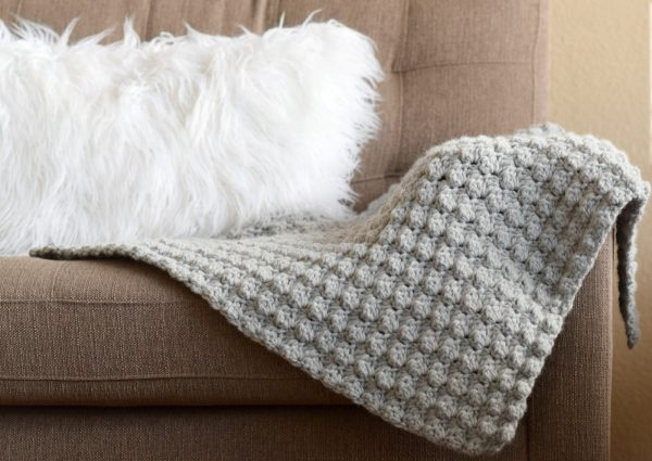 Simple Crocheted Blanket Go – To - This list of 17 easy crochet afghan patterns has a good variety of styles and stitches that will allow you to flex your crochet muscle. #easycrochetafghanpatterns #crochetafghanpatterns #crochetpatterns