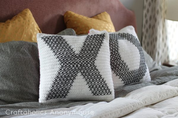 DIY Crochet and Cross-Stitch Valentine Pillows - Start making these cuddly crochet pillows, and you'll have all the hearts you can give when the day of love arrives! #crochetpillows #crochetpatterns #valentinecrochetpillows