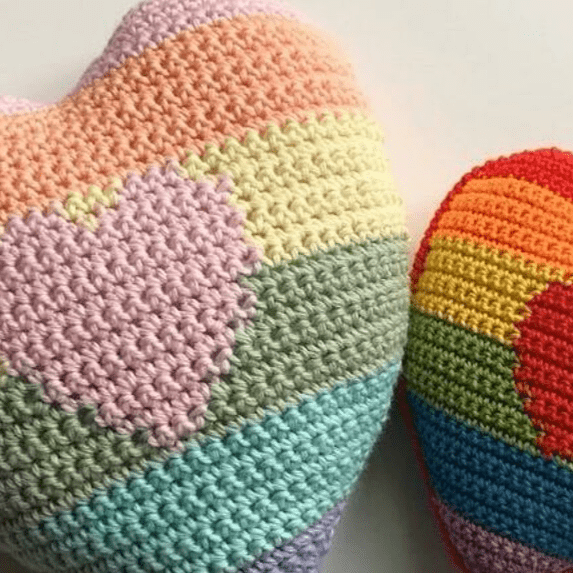 Don't Go Making My Heart - Start making these cuddly crochet pillows, and you'll have all the hearts you can give when the day of love arrives! #crochetpillows #crochetpatterns #valentinecrochetpillows