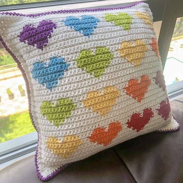 Full of Love Pillow - Start making these cuddly crochet pillows, and you'll have all the hearts you can give when the day of love arrives! #crochetpillows #crochetpatterns #valentinecrochetpillows