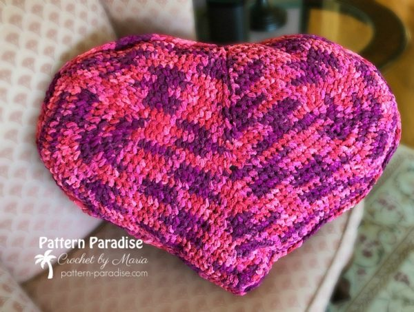 Heart Pillow - Start making these cuddly crochet pillows, and you'll have all the hearts you can give when the day of love arrives! #crochetpillows #crochetpatterns #valentinecrochetpillows
