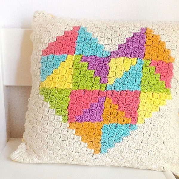 Love Triangle C2C Cushion - Start making these cuddly crochet pillows, and you'll have all the hearts you can give when the day of love arrives! #crochetpillows #crochetpatterns #valentinecrochetpillows