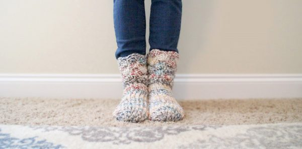 Cozy Crochet Slipper Socks - These free crochet sock patterns are the perfect gift to those who always seem to lose a pair or who prefer to keep their toes toasty at all times. #freecrochetsockpatterns #crochetsockpatterns #crochetpatterns
