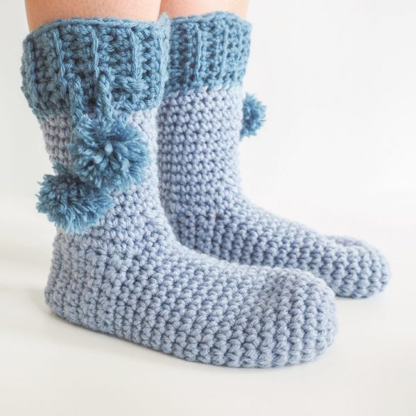 Pom Pom Slipper Socks - These free crochet sock patterns are the perfect gift to those who always seem to lose a pair or who prefer to keep their toes toasty at all times. #freecrochetsockpatterns #crochetsockpatterns #crochetpatterns