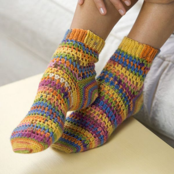 Red Heart Crochet Heart & Sole Socks - These free crochet sock patterns are the perfect gift to those who always seem to lose a pair or who prefer to keep their toes toasty at all times. #freecrochetsockpatterns #crochetsockpatterns #crochetpatterns