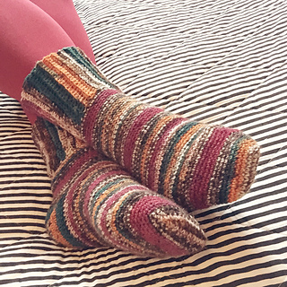 Survival Socks - These free crochet sock patterns are the perfect gift to those who always seem to lose a pair or who prefer to keep their toes toasty at all times. #freecrochetsockpatterns #crochetsockpatterns #crochetpatterns